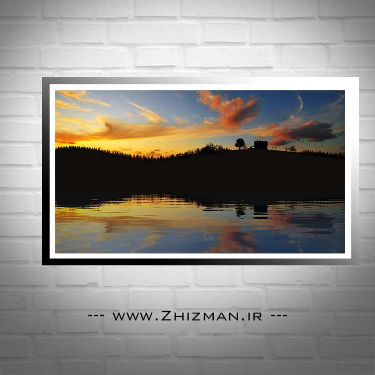 عکس غروب دریاچه و تپه
